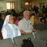 Fr. Tom and Sr. Leonarda watching a presentation by Special Kids