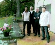 Oblate Novices (NOMI) with Rev. Lou Studer, OMI, Vicar-Provincial.      Left to Right: Vinnie Adaikalasamy, Jim Bourg, Rev. Lou Studer, OMI,                                and Antonio Guerrero.  Missing from photo: Tom Franklin
